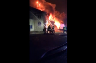 Fire and smoke rising above warehouse in north London (Photo grabbed from Reuters video)