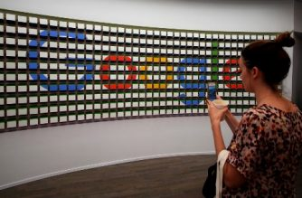 (FILES) This file photo taken on October 20, 2016 shows a woman taking pictures after the opening of Google's pop-up store in New York.   / AFP PHOTO / Jewel SAMAD