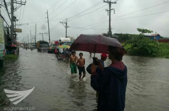 """Residents brave the floods in a part of McArthur Highway in Bulacan, as """"Maring"""" continues to batter parts of the country on Tuesday, Sept. 12, 2017. /Ian Tolentino/ Eagle News Service/"""