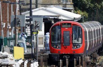 "Police forensics officers works alongside an underground tube train at a platform at Parsons Green underground tube station in west London on September 15, 2017, following an incident on an underground tube carriage at the station. British police are treating an incident on a London Underground train on Friday as an act of terrorism, saying ""a number of people"" had been injured. Twenty-two people were injured after a bomb blast on a packed London Underground train on Friday, the National Health Service said in a statement. / AFP PHOTO / Adrian DENNIS /"