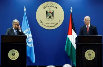 United Nations Secretary General Antonio Guterres (L) listens to translations during a joint conference with Palestinian prime minister Rami Hamdallah (R) in the West Bank city of Ramallah, on August 29, 2017.  Guterres is holding talks in Ramallah on the second day of a visit to Israel and the Palestinian territories. / AFP PHOTO / ABBAS MOMANI