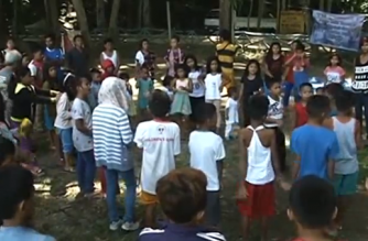 Children playing at evacuation center with female soldiers (Photo grabbed from Reuters video)