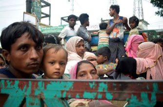 Rohingya refugees travel on an open-back truck on Teknaf-Cox's Bazar highway near Kutupalong refugee camp in Ukhiya, Bangladesh, on September 3, 2017. Around 400 people -- most of them Rohingya Muslims -- have died in communal violence searing through Myanmar's Rakhine state, the army chief's office said September 1, with tens of thousands forced to flee across the border into Bangladesh. A further 20,000 Rohingya have massed along the Bangladeshi frontier, while scores of desperate people have drowned attempting to cross the Naf, a border river, in makeshift boats. / AFP PHOTO / Jasmin RUMI