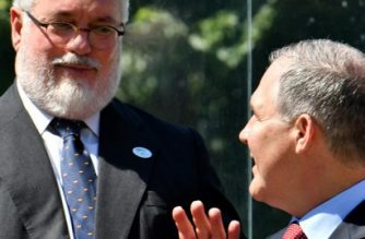 EU climate commissioner Miguel Arias Canete (L) and head of the Environmental Protection Agency (EPA) Scott Pruitt talk as they prepare to pose for a group photo during the G7 Environment summit on June 11, 2017 in Bologna.  / AFP PHOTO / Alberto PIZZOLI