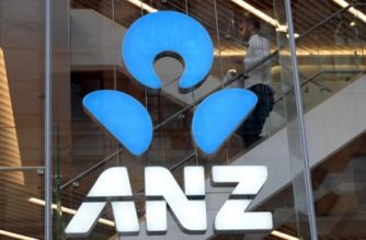 FILE PHOTO: A man walks down the stairs at ANZ Bank in Sydney on May 2, 2017.  ANZ Bank posted a six percent rise in interim net profit on the back of restructuring its business to shift the emphasis away from Asia and onto its core assets. / AFP PHOTO / SAEED KHAN