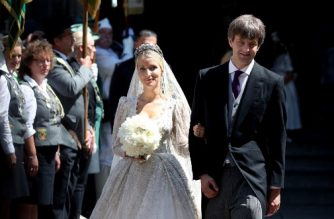 Ekaterina of Hanover (L) and Prince Ernst August (R) of Hanover leave after their church wedding ceremony in Hanover, central Germany, on July 8, 2017. Prince Ernst August of Hanover did not give in to the injunctions of his father and married his fiancee Ekaterina Malysheva, a fashion designer of Russian origin. / AFP PHOTO / RONNY HARTMANN