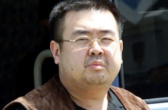 (FILES) This file photo taken on May 4, 2001 shows Kim Jong-Nam, son of North Korean leader Kim Jong-Il, getting off a bus to board an ANA905 (All Nippon Airways) airplane at Narita airport near Tokyo. Two women pleaded not guilty on October 2, 2017 to murdering Kim Jong Nam, the half-brother of North Korea's leader, at the start of their trial in Malaysia over the Cold War-style assassination that shocked the world. / AFP PHOTO / TOSHIFUMI KITAMURA