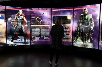 "(FILES) This file photo taken on April 13, 2016 shows a visitor looks at a display on Marvel Comics superhero ""Thor"" (L) and character ""Loki"" at the interactive Marvel Avengers STATION exhibition in the bussines district of La Defense, west of Paris, on April 13, 2016. It may not get the affection lavished on ""Iron Man"" or ""Captain America"" but the ""Thor"" franchise looks set to complete a record year for Marvel on its opening weekend, 14-15 October, 2017. Bolstered by glowing early reviews, ""Thor: Ragnarok,"" the third instalment of the God of Thunder's intergalactic exploits, is projected to take $90 to $100 million on its opening weekend.   / AFP PHOTO / MIGUEL MEDINA /"