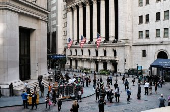 File Photo: People walk outside of the New York Stock Exchange (NYSE) through Manhattan's financial district in New York City.