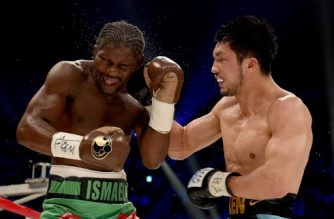 (FILES) This file photo taken on May 20, 2017 shows Hassan N'Dam of France (L) and Ryota Murata of Japan exchanging blows during the 10th round of the WBA middleweight title bout in Tokyo. Japan's Ryota Murata has promised there will be no more Mr Nice Guy as he prepares for his world middleweight title rematch against Frenchman Hassan N'Dam scheduled for October 22, 2017.  / AFP PHOTO / Toru YAMANAKA
