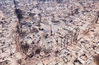 Fire damage is seen from the air in the Coffey Park neighborhood October 11, 2017, in Santa Rosa, California More than 200 fire engines and firefighting crews from around the country were being rushed to California on Wednesday to help battle infernos which have left at least 21 people dead and thousands homeless. / AFP PHOTO / Elijah Nouvelage