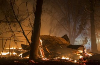SONOMA, CA - OCTOBER 14: A structure burns in the early morning hours on October 14, 2017 in Sonoma, California. At least 32 people are confirmed dead with hundreds still missing. Officials expect the death toll to rise, and now estimate that 5,700 structures have been destroyed.   David McNew/Getty Images/AFP