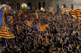 People gather to celebrate the proclamation of a Catalan republic at the Sant Jaume square in Barcelona on October 27, 2017.  Catalonia's parliament voted to declare independence from Spain and proclaim a republic, just as Madrid is poised to impose direct rule on the region to stop it in its tracks. A motion declaring independence was approved with 70 votes in favour, 10 against and two abstentions, with Catalan opposition MPs walking out of the 135-seat chamber before the vote in protest at a declaration unlikely to be given official recognition.    / AFP PHOTO / PAU BARRENA