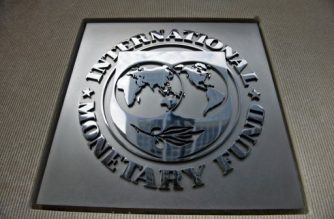 A logo is seen outside the headquarters of the International Monetary Fund June 30, 2015 in Washington, DC. AFP PHOTO/BRENDAN SMIALOWSKI / AFP PHOTO / BRENDAN SMIALOWSKI