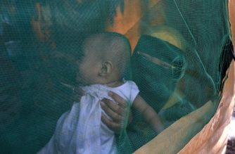 This photo taken on October 26, 2017, shows evacuee Jamalia Pindaton (R) and her toddler, who were displaced by fighting between government troops and IS-inspired Muslim militants, sitting in their tent at an evacuation centre in Balo-I town, Lanao del Sur province, on the southern island of Mindanao.  More than 350,000 people from in and around Marawi, the mainly Catholic Philippines' Islamic capital, were displaced because of the conflict, which ended on October 23 when soldiers killed the remaining gunmen inside a mosque. But, with the eastern half Marawi nearly totally destroyed and concerns over bombs planted by the militants, authorities have said it could be months or even years before many people can return.  / AFP PHOTO / TED ALJIBE / TO GO WITH AFP STORY PHILIPPINES-UNREST-CONFLICT-RECONSTRUCTION,FOCUS BY CECIL MORELLA