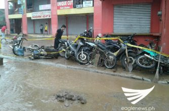 Motorcycles parked on the side were toppled down by the raging waters from the tank that burst in San Jose Del Monte, Bulacan on Friday, October 6. /Ces Rodil/Eagle News Service/