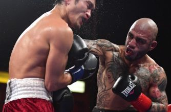 CARSON, CA - AUGUST 26: Miguel Cotto punches Yoshihiro Kamegai, as Cotto goes on to win in a 12 round unanimous decision during the WBO Junior Middleweight title fight at StubHub Center on August 26, 2017 in Carson, California.   Harry How/Getty Images/AFP