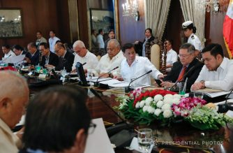(File photo) President Rodrigo Duterte discusses matters with Finance Secretary Carlos Dominguez III during the 19th Cabinet Meeting in Malacañan Palace on October 4, 2017.   (Photo by Marcelino Pascua/Presidential Photo)