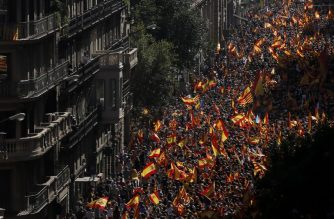 "Protesters hold Spanish flags during a demonstration called by ""Societat Civil Catalana"" (Catalan Civil Society) to support the unity of Spain on October 8, 2017 in Barcelona. Ten of thousands of flag-waving demonstrators packed central Barcelona to rally against plans by separatist leaders to declare Catalonia independent following a banned secession referendum. Catalans calling themselves a ""silent majority"" opposed to leaving Spain broke their silence after a week of mounting anxiety over the country's worst political crisis in a generation.  / AFP PHOTO / PAU BARRENA"