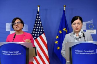 US Commerce Secretary Penny Pritzker (L) and European Union Commissioner for Justice, Consumers and Gender Equality Vera Jourova talk to the media at the EU headquarters in Brussels,  on July 12, 2016.  The European Union  launched a controversial deal with the United States aimed at curbing government spying on the personal internet infomation of European citizens. The deal replaces one struck down by the EU's top court in October, a decision which left firms like Google and Facebook in legal limbo over whether they could transfer data to their US headquarters. / AFP PHOTO / THIERRY CHARLIER