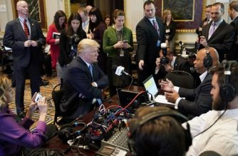US President Donald Trump looks at a reporter as he takes part in a series of radio interviews in the Eisenhower Executive Office Building, next to the White House, on October 17, 2017 in Washington, DC. / AFP PHOTO / MANDEL NGAN
