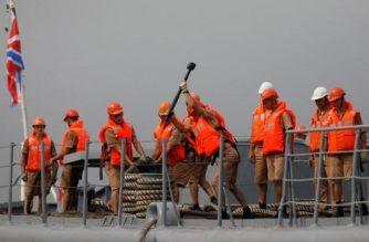 Russian sailors onboard the Admiral Panteleyev on October 20, 2017. Reuters/Dondi Tawatao/
