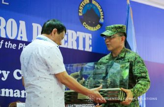 President Rodrigo Roa Duterte receives a token from Eastern Mindanao Command (EastMinCom) Commander Lt. Gen. Rey Guerrero during the 11th Founding Anniversary celebration of EastMinCom at the Naval Station Felix Apolinario in Panacan, Davao City on September 1, 2017. /Albert Alcain/ Presidential photo/