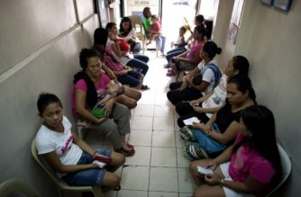 (File photo) Filipina mothers line up to receive contraceptives at a health clinic in Manila on April 23, 2014.  The Philippines has long been known as the Catholic Church's Asian stronghold, but a new birth control law highlights an increasingly liberal shift that could next see divorce legalised, activists and religious leaders say.    AFP PHOTO/NOEL CELIS / AFP PHOTO / NOEL CELIS