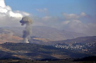 FILE PHOTO: Smokes billows from the southern Syrian Druze village of Hadar on November 3, 2017 as seen from the Israeli-annexed Golan Heights.  A suicide car bomb attack killed nine people in the government-held village of Hadar in Syria's Golan Heights, state media said, reporting clashes between government forces and rebels afterwards / AFP PHOTO / JALAA MAREY