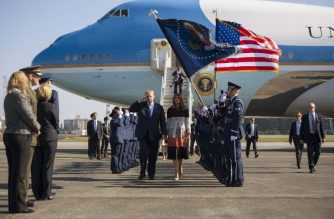 US President Donald Trump (centre L) and First Lady Melania Trump (centre R) walk through an honour cordon as they arrive at Yokota Air Base at Fussa in Tokyo on November 5, 2017. Trump touched down in Japan on November 5, kicking off the first leg of a high-stakes Asia tour set to be dominated by soaring tensions with nuclear-armed North Korea. / AFP PHOTO / JIM WATSON