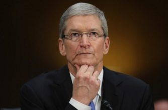"""(FILES) This file photo taken on May 20, 2013 shows Apple CEO Timothy Cook pauses while giving opening remarks while testifying before the Senate Homeland Security and Governmental Affairs Committee's Investigations Subcommittee about the company's offshore profit shifting and tax avoidance on Capitol Hill in Washington, DC.  New revelations November 6, 2017 from the """"Paradise Papers"""" shed light on Apple's tax avoidance strategy which shifted profits from one fiscal haven to another as well as loopholes employed by Nike and Formula One champion Lewis Hamilton.They are the latest disclosures from a trove of documents released by the US-based International Consortium of Investigative Journalists (ICIJ) concerning secretive offshore deals that have proved deeply embarrassing.At a 2013 congressional hearing, Apple chief Tim Cook denied the use of """"gimmicks"""" to avoid taxes. The company is now facing an EU demand for about $14.5 billion in taxes based on a ruling that its tax structure in Ireland amounted to illegal state aid. / AFP PHOTO / GETTY IMAGES NORTH AMERICA / CHIP SOMODEVILLA"""