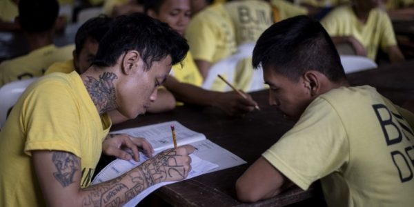 In photos:  Manila jail inmates take equivalency tests to pursue dream of a better education