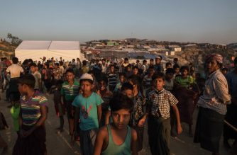 "Rohingya Muslim refugees gathers inside  the Kutupalong refugee camp in Cox's Bazar on November 26, 2017. Rohingya refugees who return to Myanmar from Bangladesh following a repatriation agreement will initially live in temporary shelters or camps, Dhaka said November 25, a day after the UN raised concern for their safety when they go back. The United Nations says more than 620,000 Rohingya have fled to Bangladesh since August and now live in squalor in the world's largest refugee camp after a military crackdown in Myanmar that the UN and Washington have said clearly constitutes ""ethnic cleansing"". / AFP PHOTO / Ed JONES"