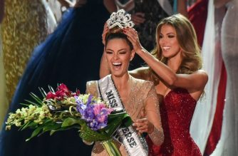 Miss South Africa 2017 Demi-Leigh Nel-Peters (L) reacts as she is crowned new Miss Universe 2017 by Miss Universe 2016 Iris Mittenaere  November 26, 2017 in Las Vegas, Nevada Beauties from across the globe converged in Las Vegas Sunday, where Miss South Africa was crowned Miss Universe. Demi-Leigh Nel-Peters, 22, edged out her rivals from Colombia and Jamaica to take the crown. Nel-Peters, a graduate in business management, said her disabled half-sister has been among her great inspirations.    / AFP PHOTO / Patrick Gray