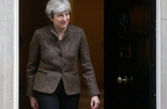 Britain's Prime Minister Theresa May reacts as she exits Downing Street in central London on November 27, 2017, to greet Turkey's Prime Minister Binali Yildirim ahead of their meeting. / AFP PHOTO / Daniel LEAL-OLIVAS