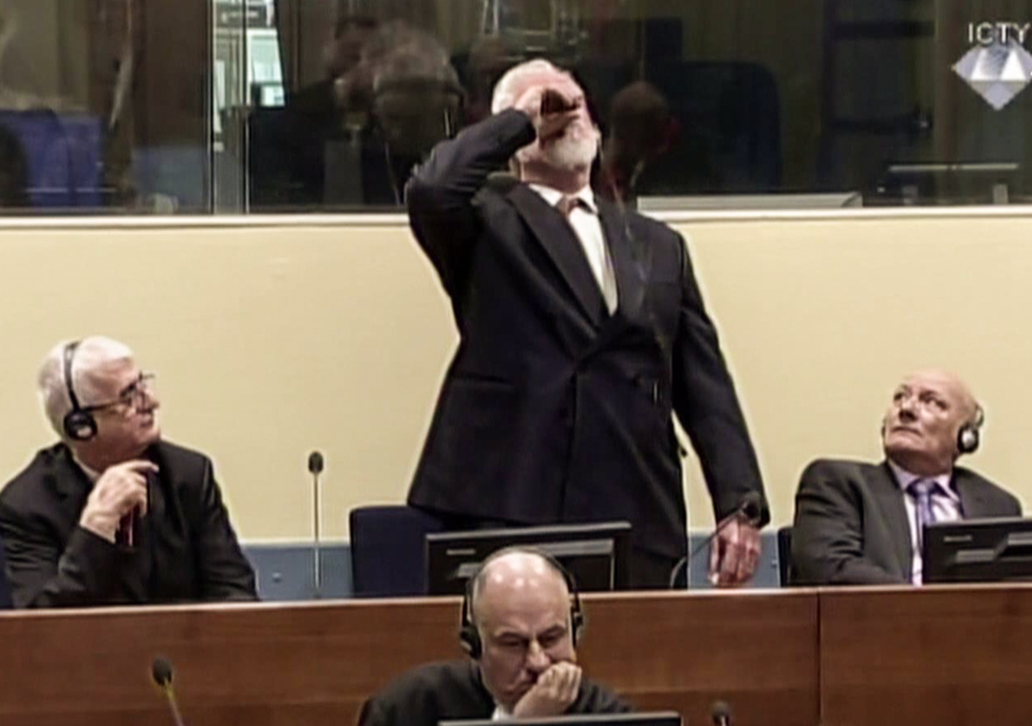 War Criminal Swallowing Court >> Dutch probe Bosnian war criminal's suicide in UN court