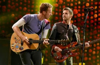 PASADENA, CA - OCTOBER 06: Musicians Chris Martin (L) and Guy Berryman of Coldplay perform at the Rose Bowl on October 6, 2017 in Pasadena, California.   Kevin Winter/Getty Images/AFP