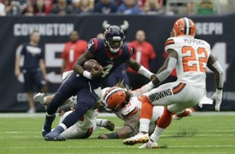 HOUSTON, TX - OCTOBER 15: Deshaun Watson #4 of the Houston Texans rushes for a first down against Danny Shelton #55 and Jabrill Peppers #22 of the Cleveland Browns in the first quarter at NRG Stadium on October 15, 2017 in Houston, Texas.   Tim Warner/Getty Images/AFP