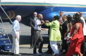 (FILES) Former US President Jimmy Carter (L) looks on as Aijalon Mahli Gomes is greeted by family members on August 27, 2010 at Logan International Airport in Boston, Massachusetts.  AFP PHOTO/John Mottern