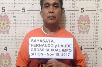 """This undated handout photo released by the Philippine National Police (PNP) on November 22, 2017 shows the mugshot of Fernando Sayasaya, 53, in Calamba, Laguna, south of Manila.  The ex-Filipino priest wanted in the United States for allegedly sexually abusing minors there faces extradition after his arrest in the Philippines where he has been hiding for 15 years, authorities said on November 22, 2017. Sayasaya is accused of molesting two brothers in the state of North Dakota when he was a Catholic priest there in the 1990s but he had fled to the Philippines before a US court issued an arrest warrant in 2002, local police said. / AFP PHOTO / PNP / HANDOUT / RESTRICTED TO EDITORIAL USE - MANDATORY CREDIT """"AFP PHOTO / PHILIPPINE NATIONAL POLICE"""" - NO MARKETING NO ADVERTISING CAMPAIGNS - DISTRIBUTED AS A SERVICE TO CLIENTS == NO ARCHIVE"""
