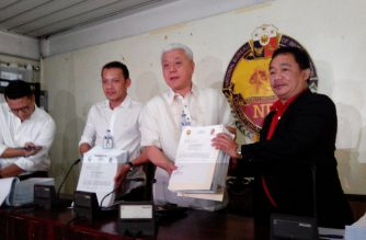 National Bureau of Investigation officials hold copies of the complaint filed against Marcelo Garbo and his wife on Wednesday, Nov. 29, 2017. /Moira Encina/Eagle News/