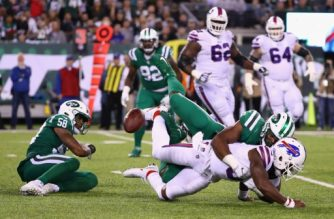 Quarterback Tyrod Taylor #5 of the Buffalo Bills is sacked by outside linebacker Jordan Jenkins #48 of the New York Jets during the fourth quarter of the game at MetLife Stadium on November 2, 2017 in East Rutherford, New Jersey.   Al Bello/Getty Images/AFP