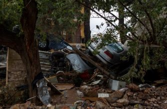 A photo shows a pile of wrecked cars and debris in Mandra, northwest of Athens, on November 16, 2017, after heavy rainfall caused flooding early on November 15.  / AFP PHOTO / Angelos Tzortzinis