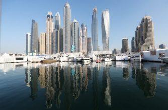 Boats are docked at the Dubai International Marine Club during the Gulf emirate's international Boat Show on February 28, 2017. / AFP PHOTO / KARIM SAHIB