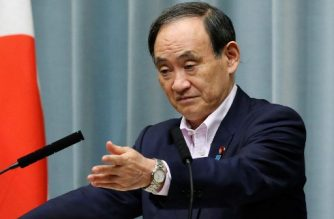 "Japan's top government spokesman Yoshihide Suga gestures during his press conference at the prime minister's official residence in Tokyo on September 4, 2017. Suga told reporters there was ""nothing special detected any atmospheric radiation from North Korea's nuclear test from monitoring posts across the country"", nor from air samples taken by the Air Self-Defense Force after September 3 blast. / AFP PHOTO / JIJI PRESS / STR / Japan OUT"