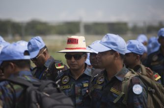 UN Bangladeshi peacekeepers of the United Nations Stabilization Mission in Haiti (MINUSTAH) prepare to leave Haiti at Toussaint Louverture International Airport in Port-au-Prince on October 8, 2017.  The long-running United Nations mission in Haiti officially ended on October 5, 2017, after 13 years, but its aim of restoring stability in the Caribbean nation has yet to be fully achieved. The United Nations Mission for Justice Support in Haiti will succeed  MINUSTAH on October 15.  / AFP PHOTO / Pierre Michel Jean