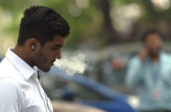 An Indian man smokes a cigarette in Mumbai on November 27, 2017. A global treaty to fight the health impact of tobacco has suffered substantial setbacks in Southeast Asia, home to some of the world's highest concentrations of smokers, a watchdog group said November 27. WHO says tobacco use causes lung cancer and heart disease, among other ailments, and kills more than seven million people each year. / AFP PHOTO / INDRANIL MUKHERJEE