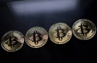 (FILES) This file photo taken on November 20, 2017 shows  Gold plated souvenir Bitcoin coins are arranged for a photograph in London.  The world's stock markets struggled for direction December 7, 2017, as investors paused for breath, while bitcoin spiked to a dizzying record above $15,000 on frenzied speculative buying, dealers said. / AFP PHOTO / Justin TALLIS