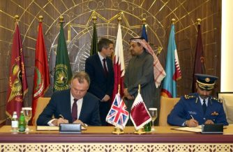 Britain's Defence Minister Gavin Williamson (C-L) talks to his Qatari counterpart Khalid bin Mohammed al-Attiyah (C-R) during an official agreement signing in the Qatari capital Doha on December 10, 2017. Qatar signed an $8 billion (6.8 billion euros) deal with Britain on December 10 to buy 24 Typhoon fighters from Britain, which comes during the worst political crisis in the region for years. Williamson said it was the biggest order for Typhoons in a decade, and it follows a billion-dollar deal signed by Qatar on December 7 to buy 12 French Dassault Aviation warplanes. The deal also includes an intention for Qatar to buy further military equipment from Britain, namely the purchase of Hawk aircraft. / AFP PHOTO / STRINGER