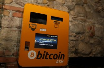 A picture shows a Bitcoin ATM on December 11, 2017 in Rovereto, northern Italy. Bitcoin surged past $18,000 after making its debut on a major global exchange but was trading lower on December 11, 2017, highlighting the volatility of the controversial digital currency that has some investors excited but others nervous. / AFP PHOTO / PIERRE TEYSSOT